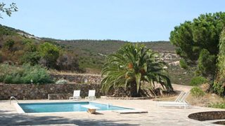 Im Gartenbereich des Ferienhauses I Piazzili befindet sich ein Pool
